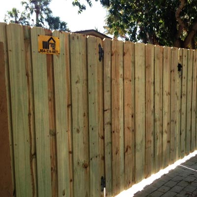 Tamarac wood fence installation